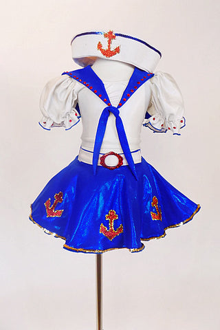 Sailor themed costume has white half top with blue collar, red  anchor motif & red crystals. Come with a blue skirt with white petticoat & white sailor hat . Front