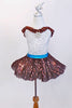 Silver leotard with brown sequined ruffle accent, has matching brown skirt with white ruffled petticoat. comes with an ornamental Chocolate Kiss hair piece. Front