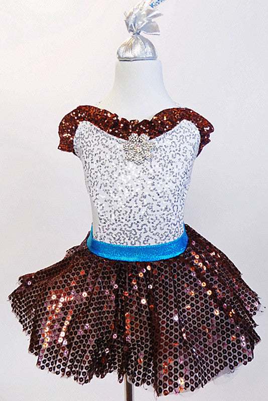 Silver leotard with brown sequined ruffle accent, has matching brown skirt with white ruffled petticoat. comes with an ornamental Chocolate Kiss hair piece. Front zoom