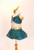Teal sequined  Princess Jasmine has drop shoulder with large jeweled broach. Skirt has petticoat with gold waistband &jewel. includes panty & gold head piece. Side