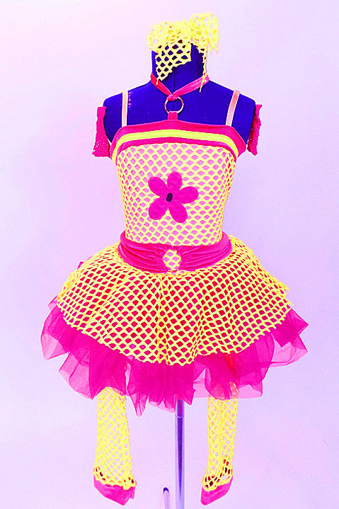 Yellow stretch net dress over bright pink skirt with a large  flower applique on the front of the bodice. Comes with  gauntlets, mesh leg warmers, and hair bow. Front
