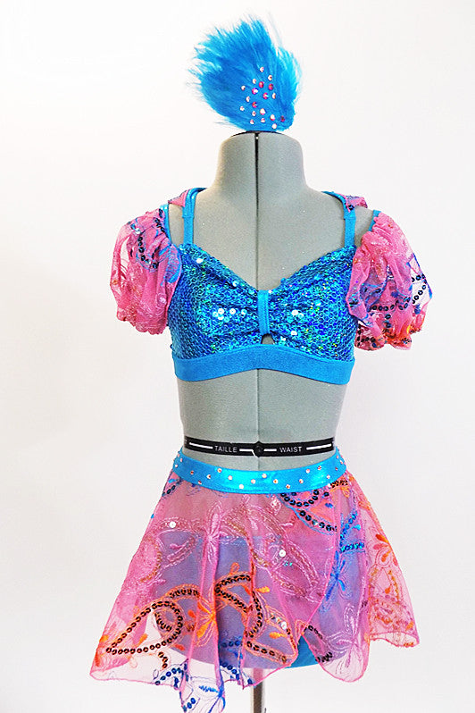 Turquoise sequined half-top with attached wing cape of pink sequined lace. Has matching lace skirt and separate turquoise panty. Comes with feather hair piece. Front Zoom