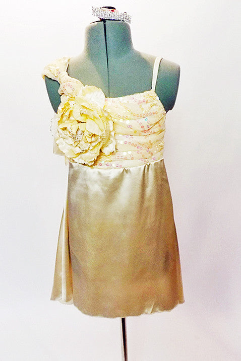 Cream satin baby-doll dress with attached panty. The bodice is s covered with a gold sequined lace with soft  bow & flower accent on the right shoulder. Front