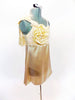 Cream satin baby-doll dress with attached panty. The bodice is s covered with a gold sequined lace with soft  bow & flower accent on the right shoulder. Side Right