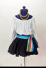 White leotard with blouson sleeves has as a matching black skirt with tulle petticoat.Comes with a striped sash and a matching  head scarf with  hoop earrings. Front