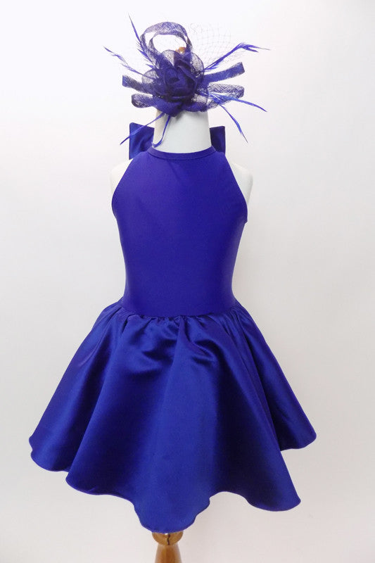 Violet blue, fully lined Lycra, keyhole back leotard dress with bow accent has stretch sateen full skirt with crisp tulle petticoat and matching hair accessory. Front