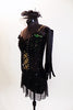 Black merry-widow style mesh dress has lace up corset front with green lace accent. Costume is covered with  crystals & has long black gloves & head piece. Side