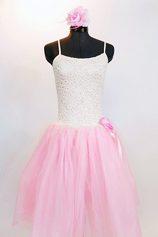 Soft pink nylon and tulle romantic ballet tutu dress has bodice with glitter cream lace and rose floral hair accessory. Front