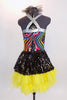 Rainbow swirled patterned leotard with yellow bottom and silver straps, has an attached skirt of ruffled, layered yellow tulle with a black sequined overlay. Back