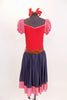 Red leotard dress has checkered pouf sleeves and denim like skirt with checkered trim. Has attached blue panty, brown leather belt and red hair bow accessories. Front