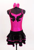 Metallic fuchsia pinch front camisole leotard has black sequined applique front. Comes with shiny black & fuchsia ruffled, skirt &matching hair accessory. Front