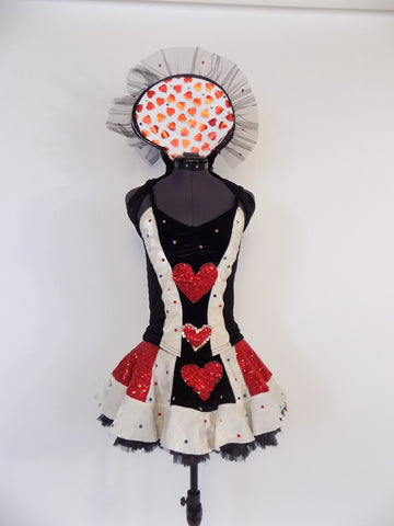 3-piece, black and white velvet with red sequin costume  has skirt add matching bodice comes with large stand-up collar. All pieces have hearts motif &crystals.Front