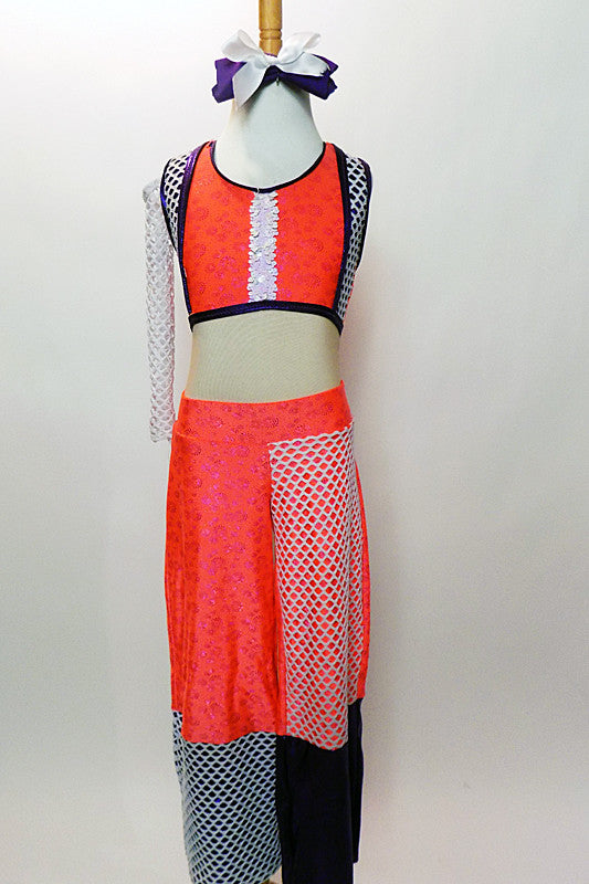 Bright iridescent coral orange two-piece has sleeveless crop-top accented with purple trim while mesh and white sequin trim. The pants have alternating accents. Front