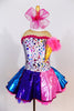 Silver leotard with colourful dots and an attached  ice cream cone with pink feather ice cream. Has  purple-pink-blue skirt with matching coloured petticoat. Front zoom