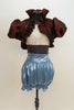 White velvet bra-top with gold pattern & burgundy iridescent taffeta shrug with ruffle and &pouf sleeves. Has light blue metallic pantaloon high waisted short. Front