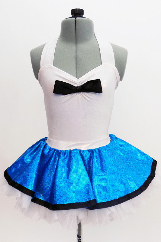 White halter collar leotard has black bow accent at front. Comes with a pull-on, turquoise skirt, that has a matching black edge & an attached white petticoat. Front