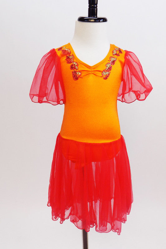 Bright orange leotard has red sheer sleeves &  red sheer  skirt. The bodice had red & gold painted leaf accents  from shoulder to front center pinch front. Front zoom