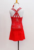 Red camisole style leotard dress has silver firework motif with crystal centers & straps that criss-cross around crystal ring on back. Has matching hair piece. Back