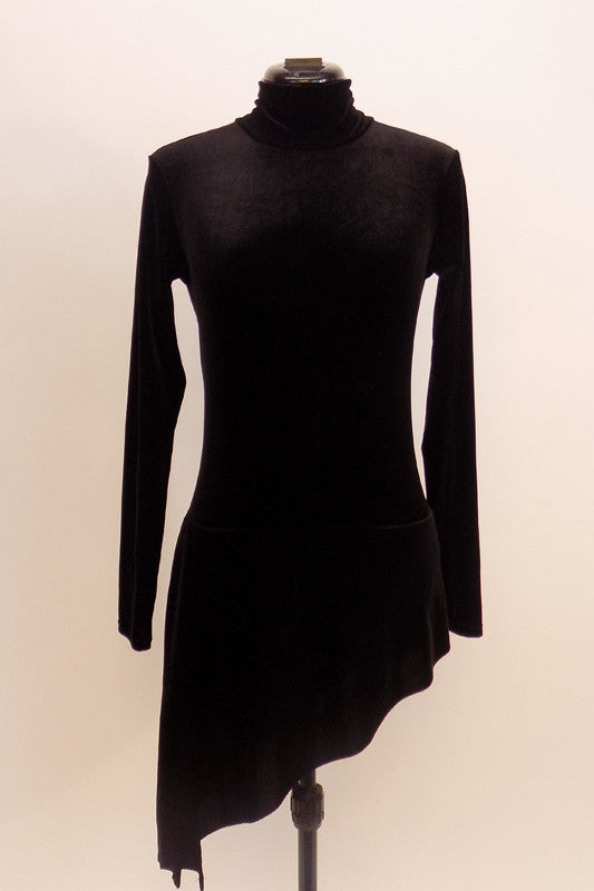 One piece black velvet leotard has long sleeves, high neck and open back. Has an attached angle skirt. Simple but pretty. Front