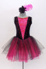 Black velvet tank leotard has pink lace insert in the bodice. Has an attached black and pink tulle romantic tutu skirt. Comes with  feather hair accessory. Front