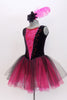 Black velvet tank leotard has pink lace insert in the bodice. Has an attached black and pink tulle romantic tutu skirt. Comes with  feather hair accessory. Side