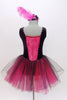 Black velvet tank leotard has pink lace insert in the bodice. Has an attached black and pink tulle romantic tutu skirt. Comes with  feather hair accessory. Back