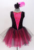 Black velvet tank leotard has pink lace insert in the bodice. Has an attached black and pink tulle romantic tutu skirt. Comes with  feather hair accessory. Front Zoom