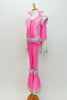 70s style Disco hot pink &silver flare jumpsuit has sequined leg, hip, shoulder & cuff accents. It has a stand-up collar & attached white cape. (Elvis wig optional) Side