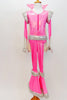 70s style Disco hot pink &silver flare jumpsuit has sequined leg, hip, shoulder & cuff accents. It has a stand-up collar & attached white cape. (Elvis wig optional) Front