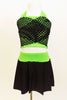 Neon green halter half-top has front cross over black mesh accent. It comes with a black skirt that has attached bottom and matching green waistband.  Front zoom