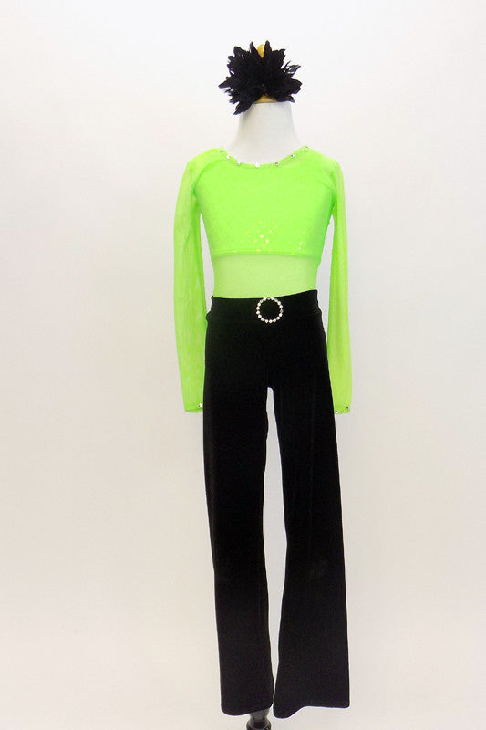 Neon green, half top rests under green, mesh, long sleeved leotard. Has black velvet pants with jeweled buckle . Comes with black hair accessory. Front