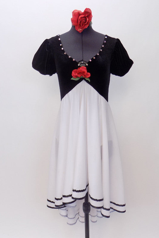 Black velvet bodice is attached to a chiffon  high low skirt with black satin edging.Costume has crystal accents & a single red rose. Has red rose hair piece. Front