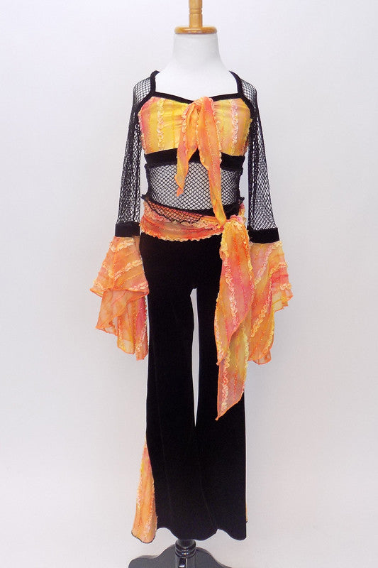 Orange tie-dye bodice with straps & edging has torso & long sleeves of loose black mesh, with  orange sleeve ruffles & black velvet pants with ruffled inserts. Front