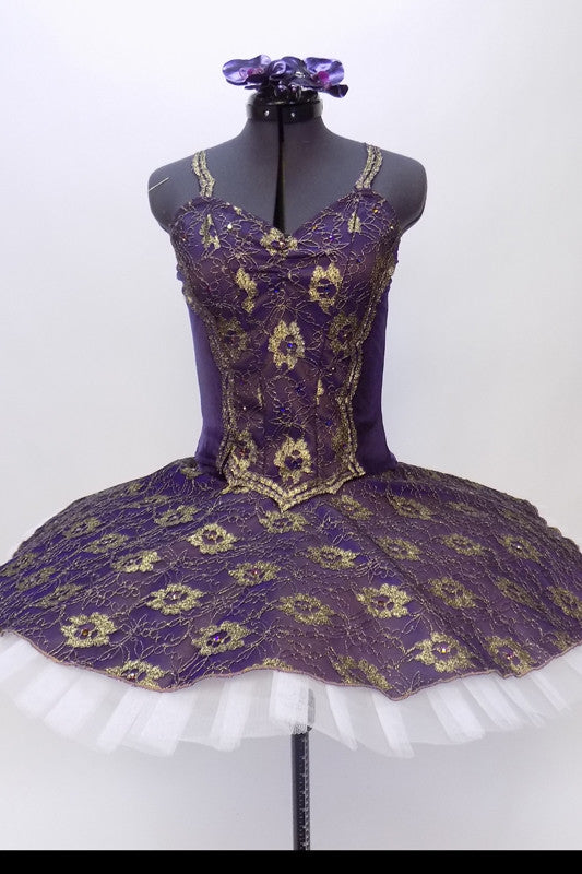 Classical tutu with white base and dark purple velvet and gold lace overlay. Bodice has lace straps and front lace center panel adorned with crystals. Front