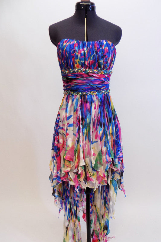 100% pure silk lined  gown, has ruched  waist & bust area with built in cups. The dress has scarves of colourful petal like accents lining the entire skirt. Front