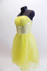 Layers of fluffy, soft yellow tulle with curly edges, form the skirt portion of this knee length dress. The waistband is ruched satin with crystals and sequins. Side