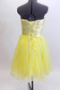 Layers of fluffy, soft yellow tulle with curly edges, form the skirt portion of this knee length dress. The waistband is ruched satin with crystals and sequins. Back