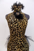 Leopard print high neck leotard has front feather-broach accent & low back.Bustle has layers of black tulle and chiffon .Comes with matching hair accessory. Front zoom
