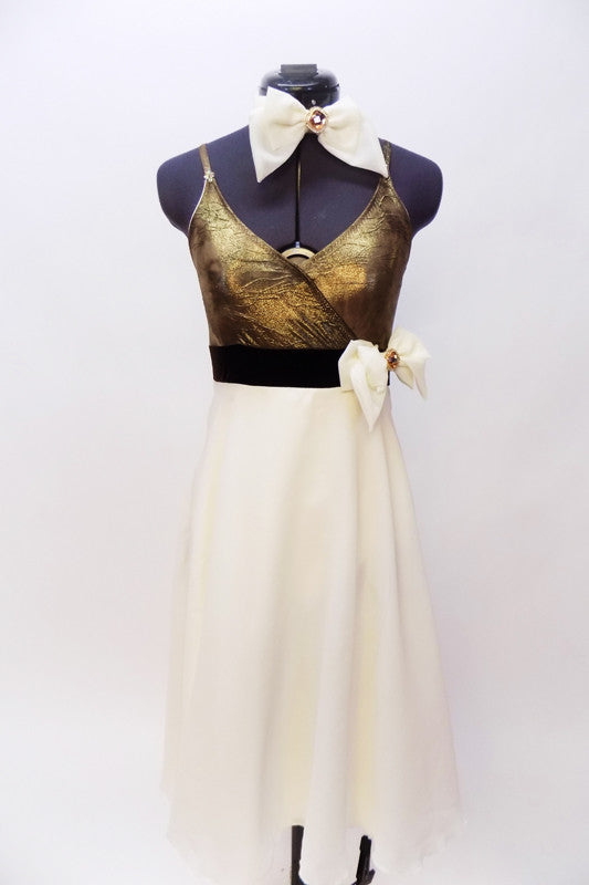 A-line dress has antique gold bust attached to long ivory layered chiffon skirt. Brown velvet waist band has crystal broach/bow accent & matching hair piece. Front