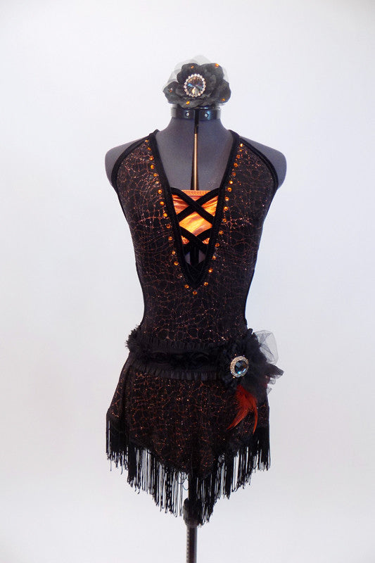Halter neck dress has criss-cross straps & plunging front with orange bust panel, Has fringe skirt & belt with feathers, broach  & matching hair piece. Front