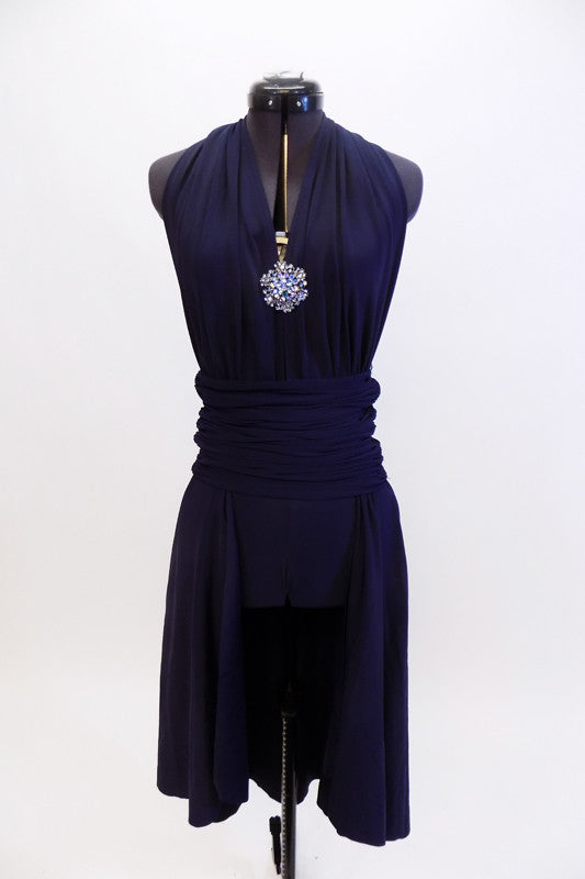 Navy halter dress has deep plunge front with large crystal broach. Has attached calf length open front skirt.Comes with pull on ruched waist band & hair piece. Front