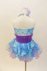 Lavender  and aqua leotard has tulle bustle skirt. Bodice is accented with lavender beads &  large purple sequined flower. Has is a large flower hair accessory. Back