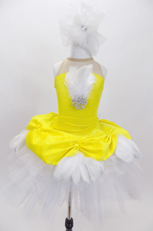 Yellow velvet overlay with white feathers rests on white tutu skirt. Matching leotard has large white crystal & feather accent &large white feather hair piece. Front