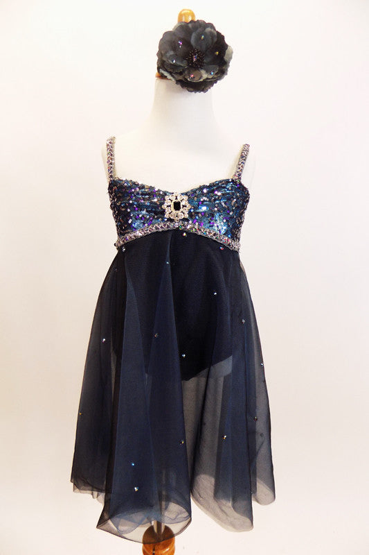 Charcoal A-line leotard dress has sweetheart bodice with  sequined lace and trim with crystal broach accent & scattered crystals. Has floral hair accessory. Front