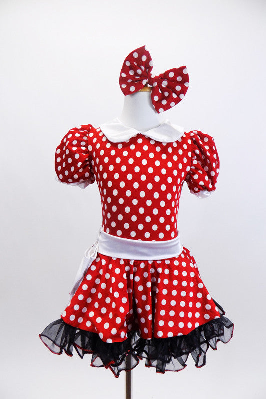 Red and white polk-a-dot dress has black petticoat with red sequin trim.Has white belt,collar & gloves. Comes with matching polk-a-dot hair bow. Front