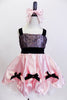 Pink satin dress is scalloped over white petticoat withk bows. Bodice has  black sequined lace overlay with pink crystals Has crystal covered pink hair bow. NEW Front