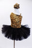 Cheetah print one shoulder tank leotard has pull-on black tutu. Fringed overlay can be worn separately. Has crystal broach accent & matching hair accessory NEW. Front