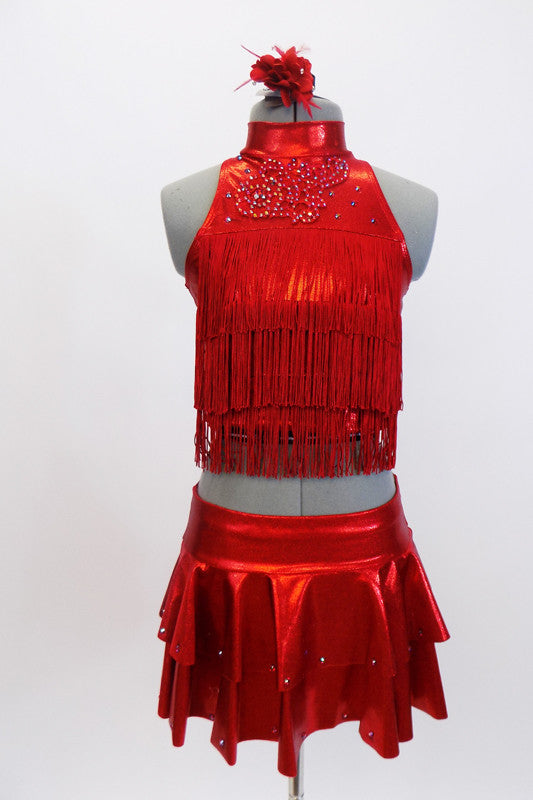 Red high neck half top has front crystal applique &layers of red fringe. Comes with hip skirt & attached panty. Has crystal accents & red floral hair accessory. Front