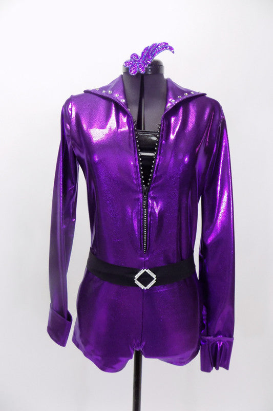 The bright purplr metallic mechanic style jump suit unitard has long sleeves, crystalled collar & jeweled zipper. Comes with crystal  belt & sequined hair accessory. Front
