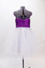 White curly edge tulle boned dress has ruched purple satin waist band with large jewel accents. There is scattered amethyst Swarovski crystals throughout dress. Back
